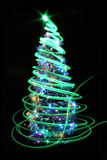Colro christmas tree. Christmas tree isolated on the black background Stock Image