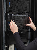 Colse-up of a IT consultant installing server in datacenter Stock Photos