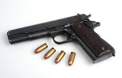 Colt .45 service automatic pistol and ammo. The famous Colt45 automatic pistol and ammo Royalty Free Stock Photo