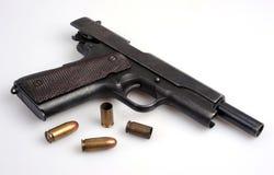 Colt automatic pistol. The ubiquitous Colt . 45 automatic service pistol. Empty cases and live ammo Stock Images