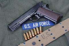 Colt goverment 1911 with us air force uniform Stock Image