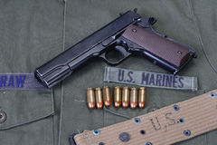 Colt goverment 1911 with us marines uniform Royalty Free Stock Photo