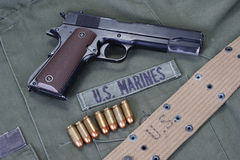 Colt goverment 1911 with us marines uniform Royalty Free Stock Images