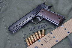 Colt goverment 1911 with us navy uniform Stock Photography