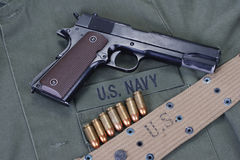 Colt goverment 1911 with us navy uniform Royalty Free Stock Image