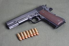 Colt government m1911. Background with colt government m1911 royalty free stock image