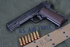 Colt government M1911 with us air force uniform. Background royalty free stock image