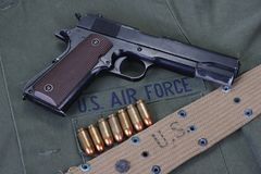 Colt government M1911 with us air force uniform. Background royalty free stock photography