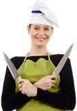 Coltelli della tenuta del cuoco unico della donna Fotografia Stock Libera da Diritti