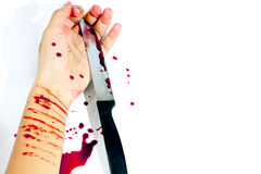 Coltello con sangue dal suicidio Immagine Stock