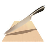 Coltello d'acciaio e un bordo di legno Fotografie Stock Libere da Diritti