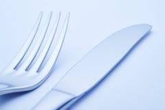Coltello e dettaglio della forcella nel tono blu cutlery Fotografie Stock Libere da Diritti