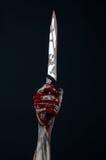 Coltello sanguinoso del demone dello zombie delle mani Fotografia Stock Libera da Diritti