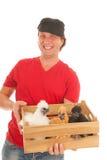 Coltivatore con i polli Fotografia Stock