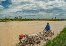 Coltivatore su un trattore Fotografia Stock Libera da Diritti