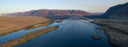 Columbia River Aerial View at Sunset South To Beverly Washington. Sun lights up the ridge behind the waterfront town of Beverly Washington as the Columbia River stock image