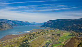 Columbia River Gorge National Scenic Area. Scenic view of Columbia River Gorge receding under blue sky and cloudscape Royalty Free Stock Photography