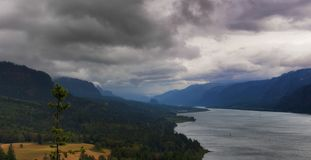 Columbia River Gorge. View from Cape Horn on the Washington side of the Columbia River Gorge.  Heavy clouds bring welcoming rains which help in fighting a forest Stock Image