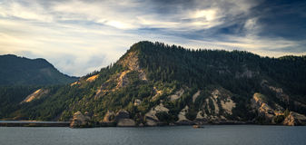 Columbia River Hillside. A hillside at sunsets constructs a wall for the columbia river Royalty Free Stock Image