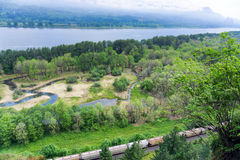 Columbia River and Train. View of a train passing through the Columbia River Gorge near Portland, Oregon stock photos