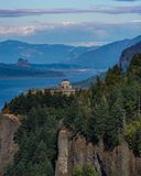 The Columbia River and Vista House. A view of Vista House and the Columbia Gorge with fire damaged hills in the distance.  Taken the day traffic was reopened to Stock Photography