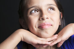 Columbian Little Girl Fun Look in front of a black Stock Photos