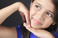 Columbian Little Girl Fun Look in front of a black Royalty Free Stock Images