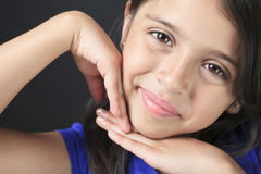Columbian Little Girl Fun Look in front of a black Stock Photography