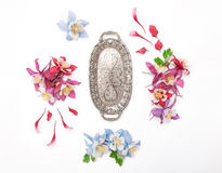 Columbines flower frame and vintage silver plate Royalty Free Stock Image
