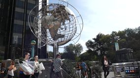 Columbus Circle. In Midtown Manhattan. The silver globe is outside of Trump International Hotel and Tower, a hotel and condominium residences building belonging stock video