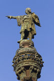 Columbus column in Barcelona. At the end of the famous street Las Ramblas. He is pointing to America Royalty Free Stock Images