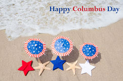 Columbus Day  background with starfishes. And decorations on the sandy beach Royalty Free Stock Photography