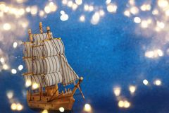 Columbus day concept with old ship over blue glitter background Stock Images