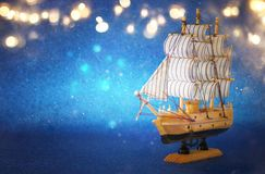 Columbus day concept with old ship over blue glitter background Royalty Free Stock Photo