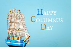 Columbus day concept with old ship over wooden background.  Stock Images