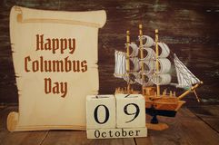 Columbus day concept with old ship over wooden background Royalty Free Stock Photo