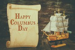 Columbus day concept with old ship over wooden background Stock Images
