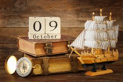 Columbus day concept with old ship over wooden background Royalty Free Stock Images