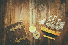 Columbus day concept with old ship over wooden background Royalty Free Stock Image