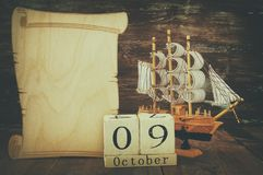 Columbus day concept with old ship over wooden background Stock Image