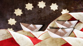 Columbus Day. Flag Waves and Three Boats. Columbus Day. Flag Waves and Three Paper Boats Stock Photos