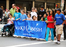 Columbus Day Parade. Group from the Make A Wish foundation marching on 5th avenue during the 67th Annual New York City Columbus Day Parade Royalty Free Stock Photos