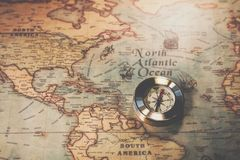 Columbus day and world map with compass stock image