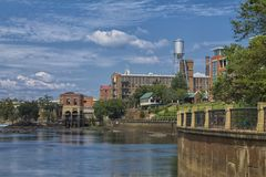 The Columbus Georgia River Walk. Photo taken on the Columbus River Walk, facing towards the Historical downtown Mill, located in Columbus, Georgia stock image