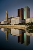 Columbus Ohio Skyline at Sunset. With lights on reflected in Scioto River Stock Photo