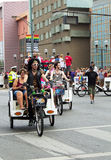 Columbus PRIDE parade bike taxi drivers Royalty Free Stock Photo