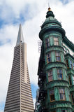 Columbus Tower -Sentinel Building - against Transamerica Pyramid Royalty Free Stock Photography