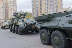 Column of armored personnel carriers. On the street near the exhibition center stock image
