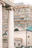 Column on background of modern buildings Royalty Free Stock Photography