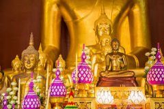 Column of buddha in front of biggest buddha in public temple, Thailand Stock Image